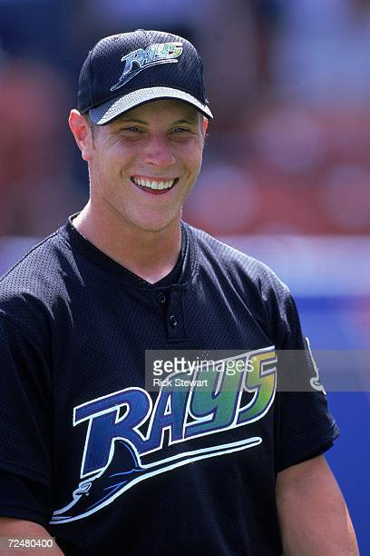Josh Hamilton of the Tampa Bay Devil Rays smiles and looks on during the Spring Training Game against the Cleveland Indians at Chain of Lakes Park in...