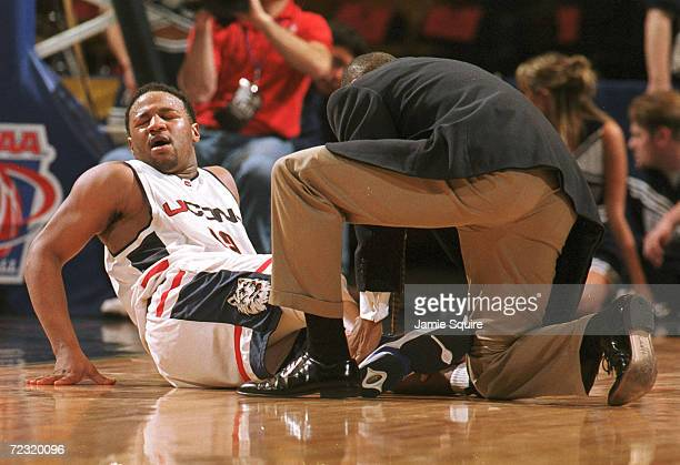 Khalid ElAmin of UConn goes down with a high ankle sprain during the second half of their 7567 victory over Utah State during the NCAA tournament in...