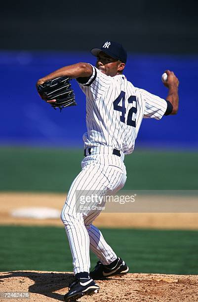 Mariano Rivera of the New York Yankees pitches the ball during the Spring Training Game against the Toronto Blue Jays at Legends Field in Tampa Bay...