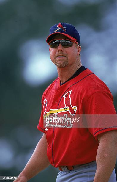 Mark McGwire of the St Louis Cardinals looks on the field during a Spring Training Game against the Los Angeles Dodgers at the Holman Stadium in Vero...