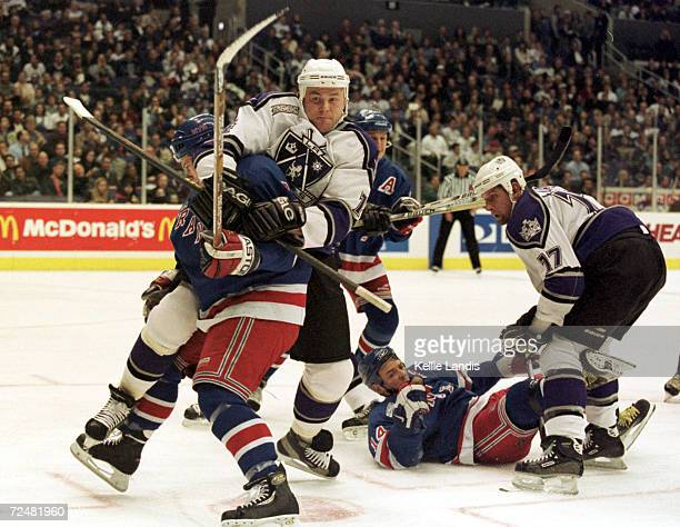 Mattias Norstrom of the Los Angeles Kings checks Michael York of the New York Rangers during the first period of their game at Staples Center in Los...