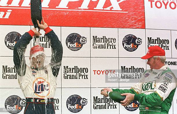 Max Papis of the Shell/Miller Lite Team Rahal celebrates his first victory with third placed Paul Tracy at the Marlboro Grand Prix of Miami during...