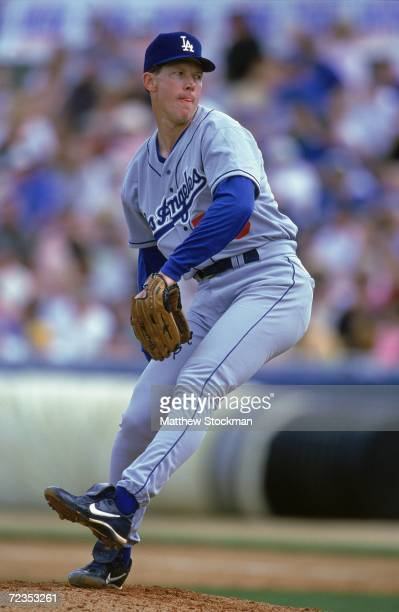 Orel Hershiser of the Los Angeles Dodgers winds back to pitch the ball during the Spring Training Game against the New York Mets in Port St Lucie...