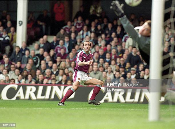 Paolo Di Canio scores the first goal for West Ham United during the FA Carling Premiership match against Wimbledon at Upton Park in London West Ham...