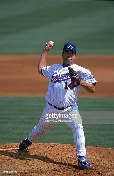 Pitcher Hideki Irabu of the Montreal Expos winds up for the pitch during the Spring Training Game against the New York Mets at Rodger Dean Stadium in...