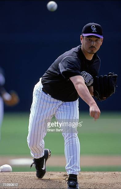 Pitcher Masato Yoshii of the Colorado Rockies pitches the ball during the Spring Training Game against the Milwaukee Brewers at Hi Corbett Field in...