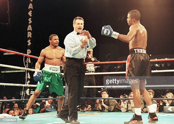 Referee Mitch Halpern calls timeout before warning Felix Trinidad of a lowblow on David Reid during the third round of their WBA Super Welterwight...