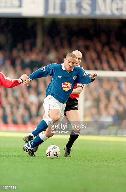 Stan Collymore of Leicester City is challenged by Jaap Stam of Manchester United during the FA Carling Premiership match at Filbert Street in...