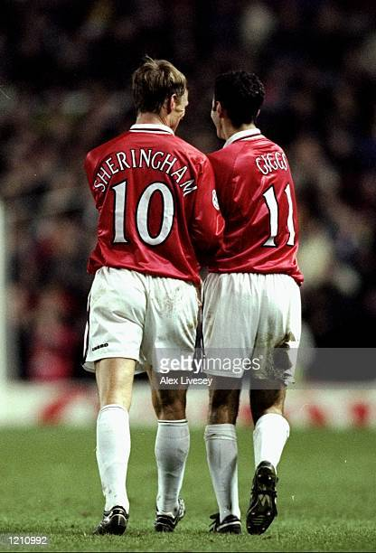 Teddy Sheringham and Ryan Giggs of Manchester United celebrate against Bordeaux during the UEFA Champions League group B match at Old Trafford in...