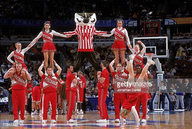 The Cheerleaders and the Mascot of the Wisconsin Badgers perform during the Big 10 Tounament Game against the Purdue Boilermakers at the United...