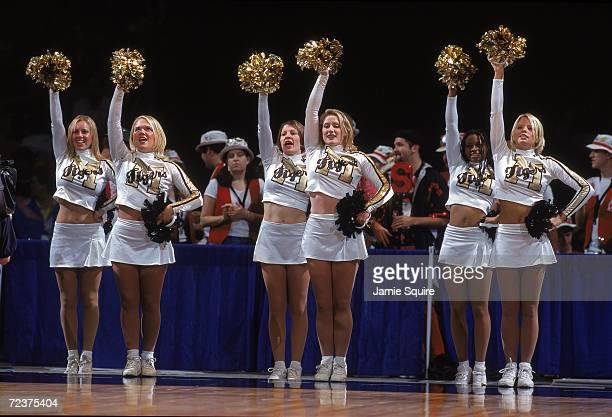 The Cheerleaders of the Missouri Tigers cheer from the sidelines during the first round of the NCAA Tournament Game against the North Carolina Tar...