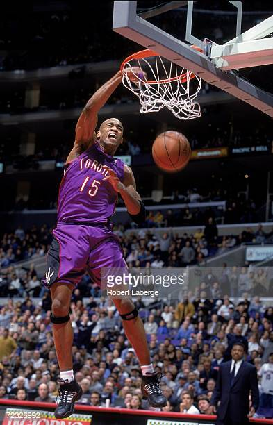 Vince Carter of the Toronto Raptors makes a slam dunk during a game against the Los Angeles Clippers at the Staples Center in Los Angeles California...