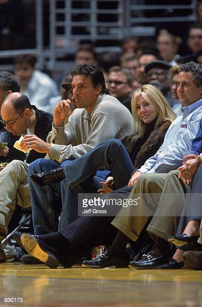 Actress Heather Locklear smiles as she watches the game between the Los Angeles Lakers and the Boston Celtics at the Staples Center in Los Angeles...