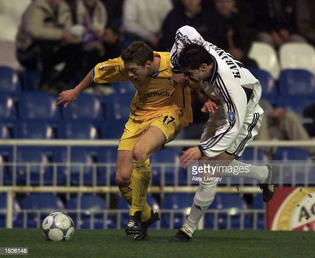 Alan Smith of Leeds gets past Aitor Karanka of Madrid during the Real Madrid v Leeds United UEFA Champions League Group D match at the Bernabeu...