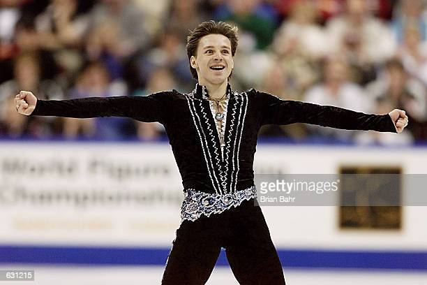 Alexander Abt of Russia exults as he finishes skating during the short program of the men's competition at the 2001 World Figure Skating...