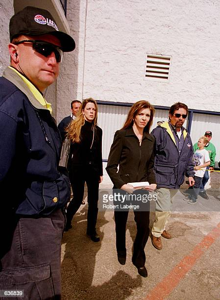 Amidst security and sympathy Teresa Earnhardt the widow of the late Dale Earnhardt emerges from a press conference after making a statement to the...