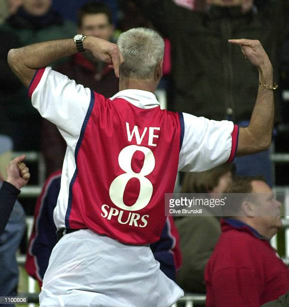 Arsenal fans celebrate qualifying for the quater finals of the Champions League during the match between Bayern Munich and Arsenal in Group C of the...