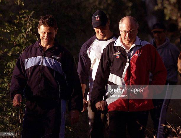 Australian Prime Minister John Howard on his morning walk with former NRL Player Wayne Pearce and current player Trent Barrett in Canberra Australia...