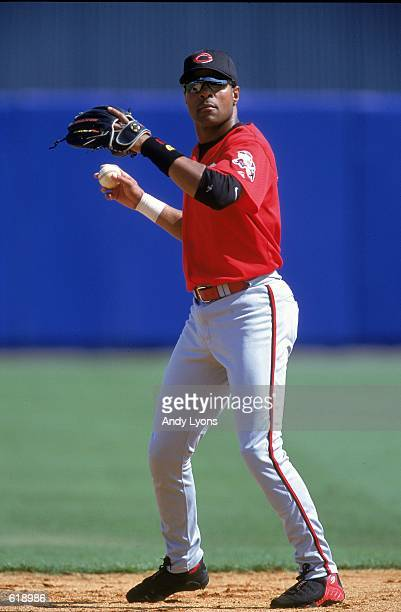 Barry Larkin of the Cincinnati Reds looks to throw the ball during the Spring Training game against the Cleveland Indians at the Chain of Lakes in...