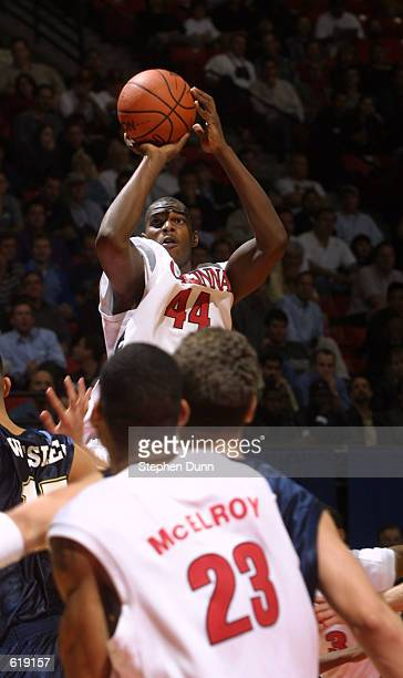 BJ Grove of Cincinnati shoots over the Brigham Young University defense during the first round of the Men's NCAA Tournament at Cox Arena in San Diego...