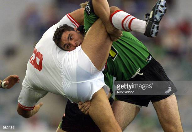 Brad Kelly#17 of the Raiders tackles Craig Smith of the Dragons during the NRL match between the Canberra Raiders and the St George Illawarra Dragons...