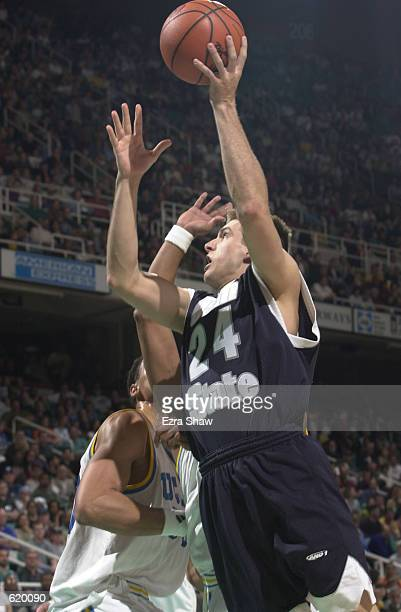 Brennan Ray of Utah State puts up a shot during their game against UCLA in the second round of the Men's NCAA Basketball Tournament at the Greensboro...