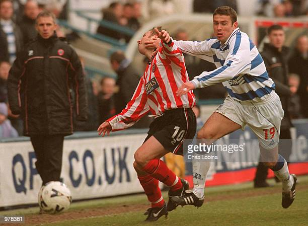 Christer Warren of Queens Park Ranges is tackles Paul Delvin of Sheffield United during the Nationwide First Division match between Queens Park...