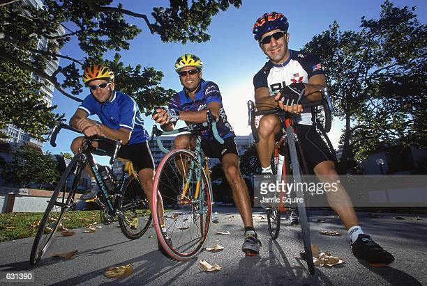 Christiano da Matta laughs with Christiano Fittipaldi and Tony Kanan as they pose on their bikes for a CART Lifestyles portrait in Miami...