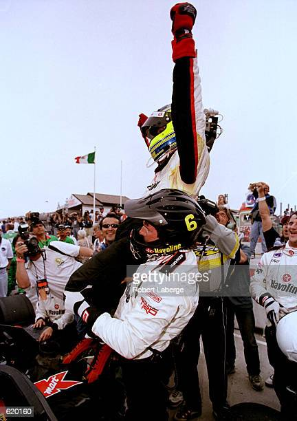 Cristiano da Matta celebrates winning the Tecate Telmex Monterrey Grand Prix, round one of the CART FedEx Championship Series at Fundidora Park,...