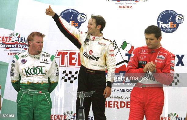 Cristiano da Matta salutes his victory with second placed Gil de Feran and third placed Paul Tracy at the Tecate Telmex Monterrey Grand Prix, round...