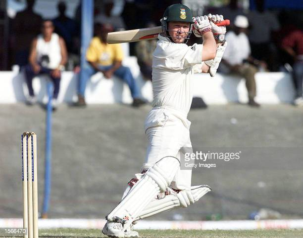 Darryl Cullinan plays a cut off the back foot during the 2nd Test played between South Africa and the West Indies at Queens Park Oval in Port of...