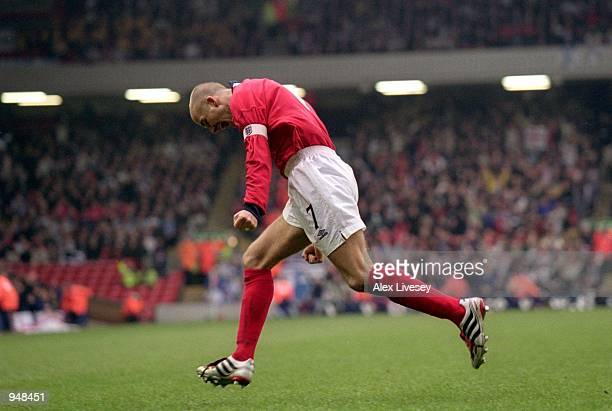 David Beckham of England celebrates scoring the winning goal during the World Cup 2002 Group 9 Qualifying match against Finland played at Anfield in...