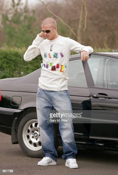 David Beckham of Manchester United and England arrives for training wearing a new TShirt in Manchester England Mandatory Credit Gary M Prior/Allsport