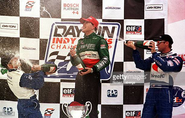 Derek Higgins, center, celebrates winning the Indy Lights race with Townsed Bell, right, and third placed Jon Fogarty, left, at the Tecate Telmex...