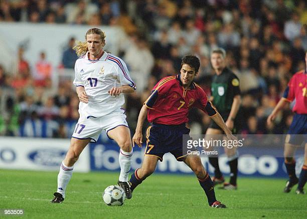 Emmanuel Petit of France holds the ball up against Raul of Spain during the International Friendly match played at the Estadio Mestalla in Valencia...