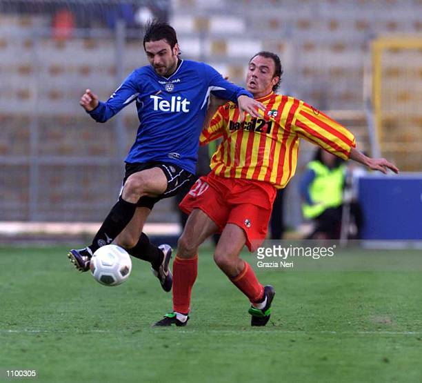 Fiore of Lecce and Giorgetti of Udinese in action during a Serie A 22th Round League match between Lecce and Udinese played at the Via del Mare...