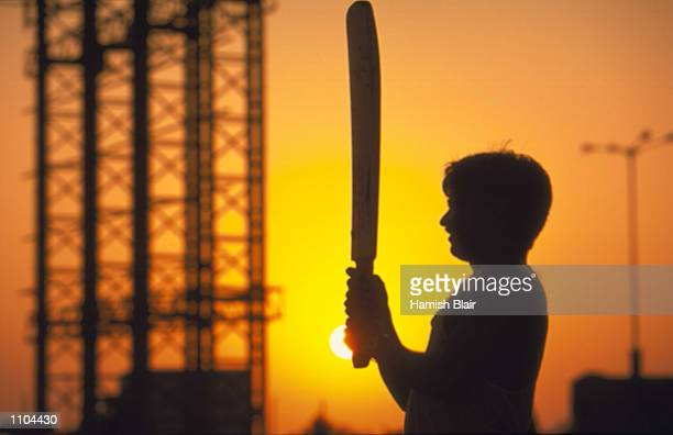 General scenes of a boy playing cricket in the streets during the Australian Cricket Tour of India in Mumbai India Mandatory Credit Hamish...