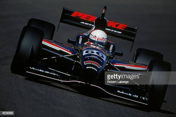 Gil de Ferran comes around a corner during the Pennzoil Copper World Indy 200 at the Phoenix International Raceway in Phoenix ArizonaMandatory Credit...