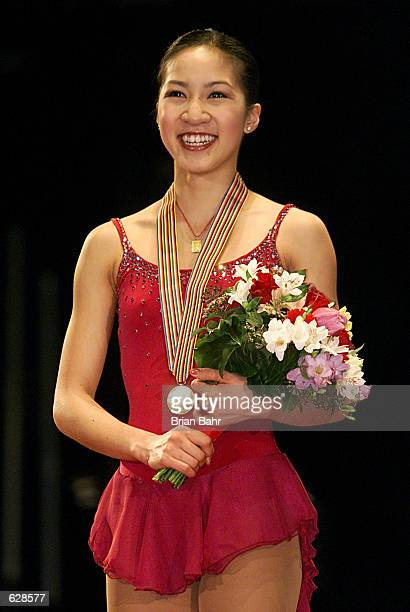 Gold medalist Michelle Kwan of the USA stands on the podium with her medal at the 2001 World Figure Skating Championships at the GM Place in...