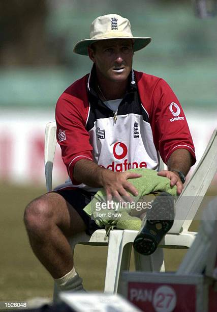 Graham Thorpe of England puts his leg on ice after injuring himself in training during the England nets session at the Asgiriya Stadium Kandy Sri...