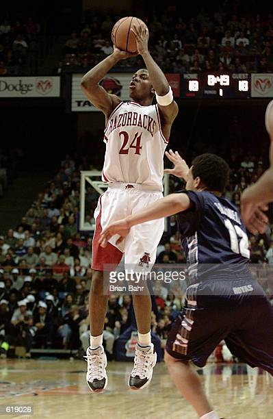 Guard Joe Johnson of the Arkansas Razorbacks shoots the ball as guard Kevin Braswell of the Georgetown Hoyas tries to rush him during the first round...