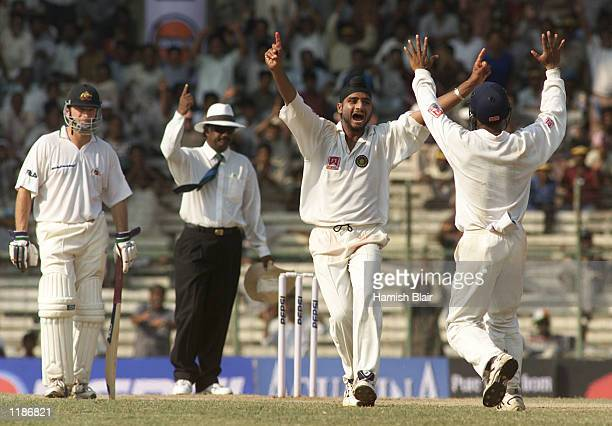 Harbhajan Singh of India celebrates after dismissing Ricky Ponting of Australia for 11 with Steve Waugh of Australia looking on during day four of...