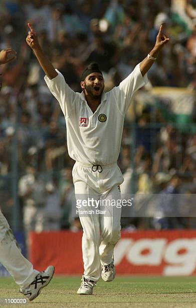 Harbhajan Singh of India claims the wicket of Adam Gilchrist of Australia the second wicket of a hat trick during day one of the 2nd Test between...