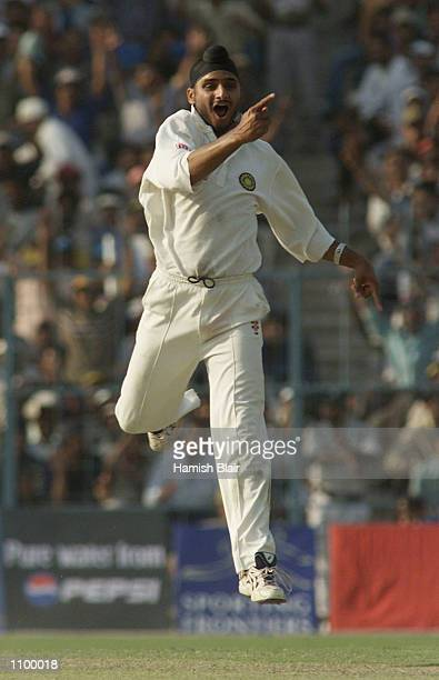 Harbhajan Singh of India claims the wicket of Ricky Ponting of Australia the first wicket of a hat trick during day one of the 2nd Test between India...