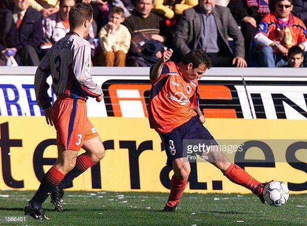 Ivan Perez of Numancia and Frank De Boer of Barcelona in action during the Primera Liga match between Numancia and Barcelona at the Los Pajaritos...