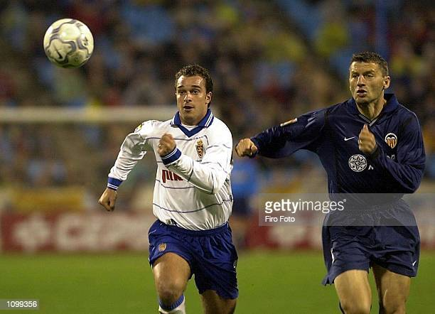 Jamelli of Zaragoza pursues the ball under pressure from Djukic of Valencia during the Real Zaragoza v CF Valencia La Liga match played at La...