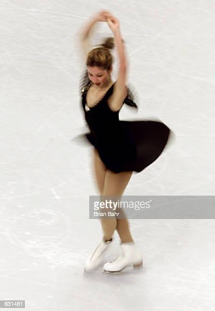 Jennifer Robinson of Canada spins during the qualifying free skate program of the women's competition at the 2001 World Figure Skating Championships...