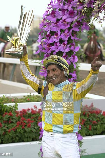 Jockey Jorge Chavez celebrates riding Monarchos to victory in the Florida Derby at Gulfstream Park in Hallandale Florida <DIGITAL IMAGE> Mandatory...
