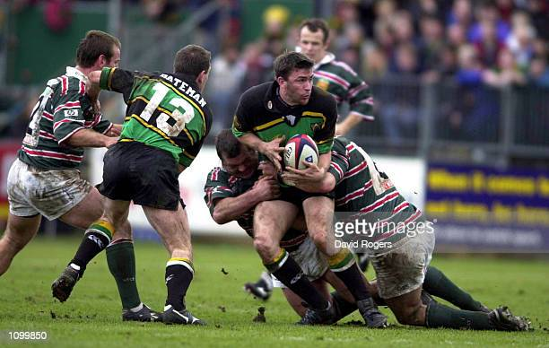 John Leslie of Northampton Saints is tackled by Darren Garforth of Leicester Tigers during the Zurich Premiership match between Northampton Saints...