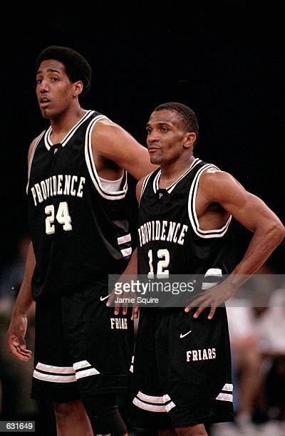 John Linehan and Erron Maxey of the Providence Friars watch the action during the Big Ten Conference game against the Pennsylvania State Nittany...